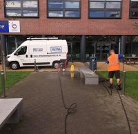 Picture of Ultra Cleaning Service jet washing a bench outside an education facility. Click here for more details about Ultra Cleaning Service's jet washing and rendering cleaning solutions
