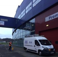A member of the Ultra Cleaning Service team using reach and wash to clean high level windows - click the picture to learn more about Other Commercial Contract Cleaning Solutions from Ultra Cleaning Service