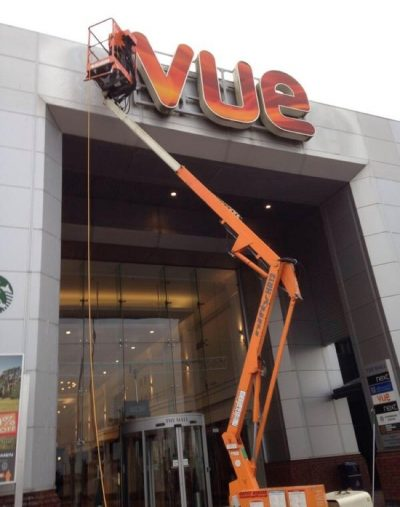 Picture of high level external sign and banner cleaning - introducing Ultra Cleaning Service's Banner Installation and Banner Cleaning services