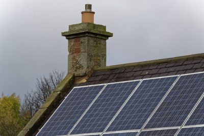 Picture of a roof with solar panels fitted. Introducing Ultra Cleaning Service's solar panel and roof cleaning solutions